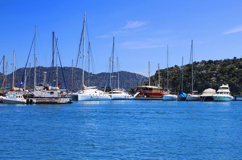 Yachts and boats in marina stock photos