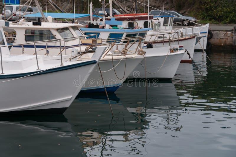 Yachts and boats at moorage, on berth. Marine transportation, travel by sea royalty free stock images