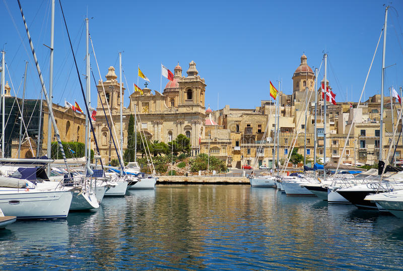 The yachts and boats moored in the harbor in Dockyard creek. Birgu. Malta. The yachts and boats moored in the harbor of Dockyard creek in front of St Lawrence royalty free stock photography