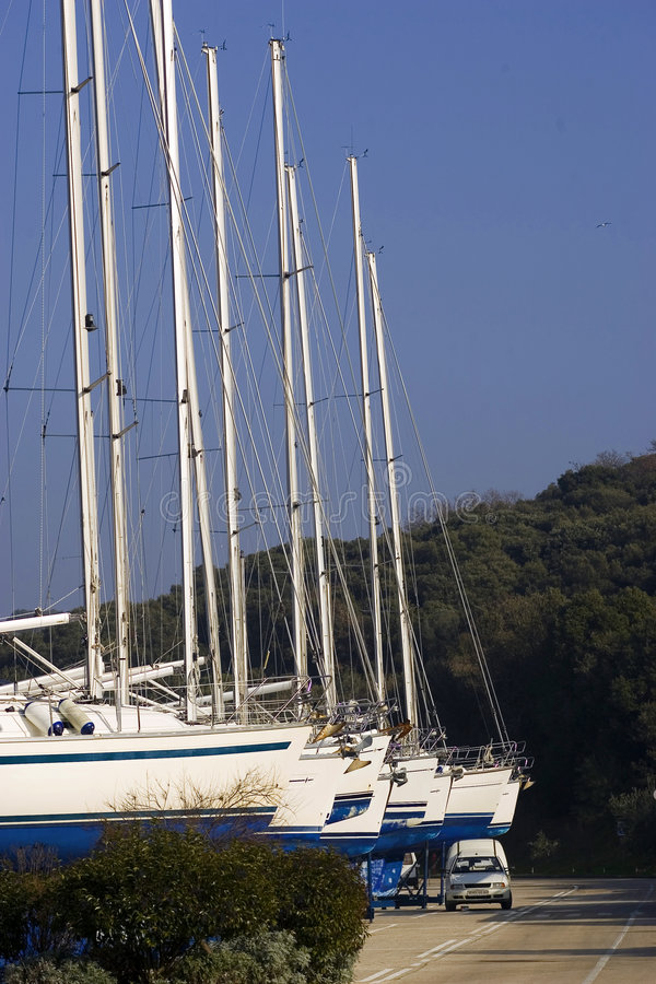 Yachts in dry dock royalty free stock photography