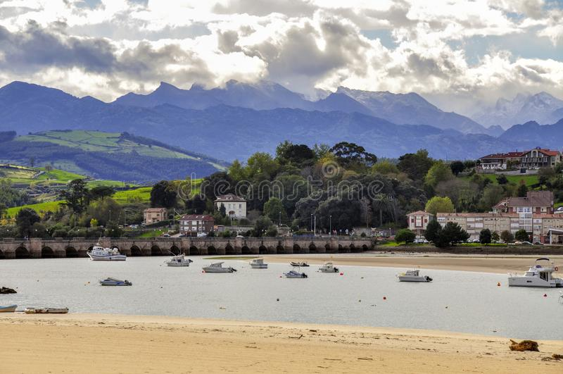 Yachts and fishing boats in the closed bay of the Cantabrian Sea. San Vicente de la Barquera, Cantabria, Spain - October 30, 2010: Yachts and fishing boats in stock photo