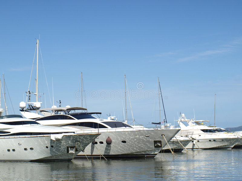 Yachts in french riviera harbor stock photos