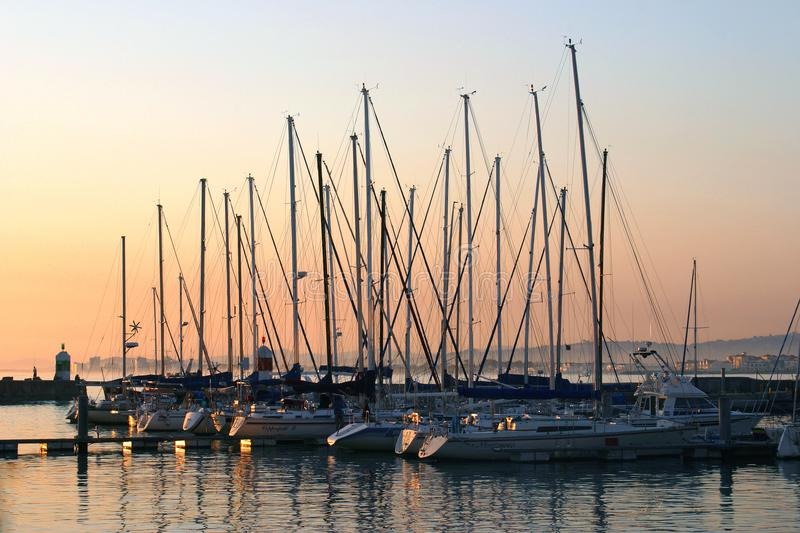 Yachts in Gordons Bay Harbour at sunset stock photo