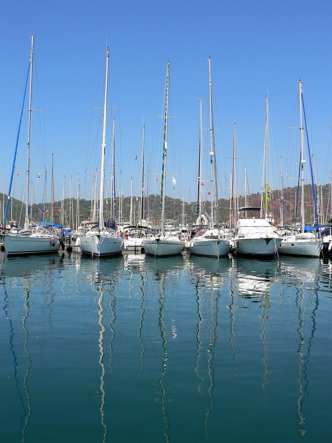 Yachts in the harbor of Fethiye city, located in western Turkey and their reflections in the water. stock photography