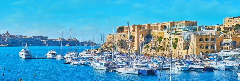 Yachts in Kalkara marina, Malta. The picturesque panorama of Kalkara marina with yachts at the shipyards and medieval Villa Bighi Palazzo Bichi, Royal Naval stock photos