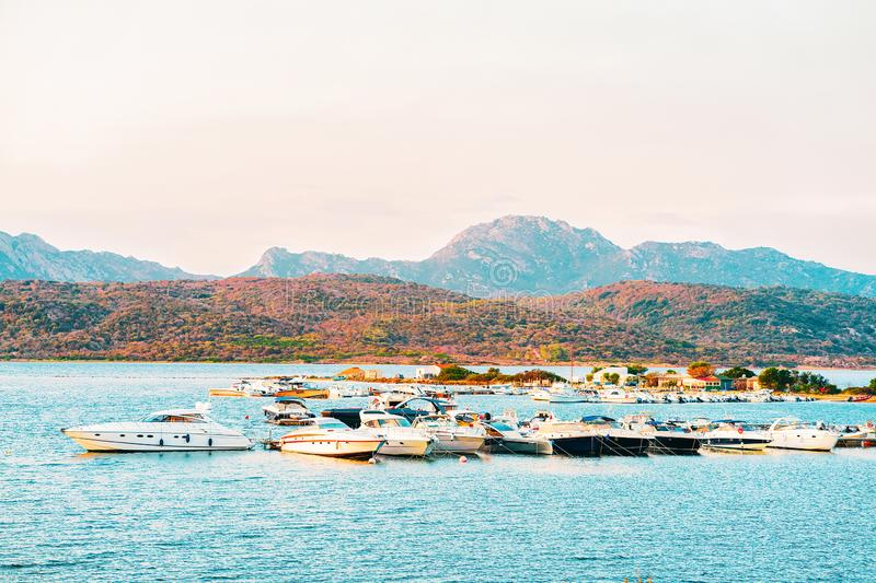 Yachts on the Mediterranean Sea on Costa Smeralda. In Sardinia in Italy at sunrise royalty free stock images