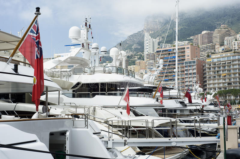 Yachts at Monaco. Yachts moored at Port Hercule in the La Condamine district of Monaco, close to Monte Carlo stock images