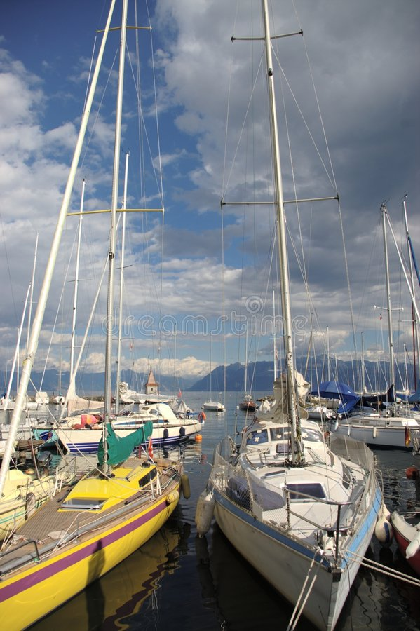 Yachts moored in harbor royalty free stock image