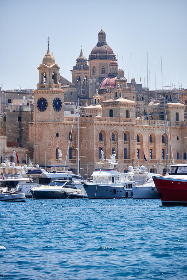 The yachts moored in the harbor in Dockyard creek in front of Ma. Birgu, MALTA - JULY 23, 2015: The yachts moored in the harbor in Dockyard creek with the view royalty free stock photo