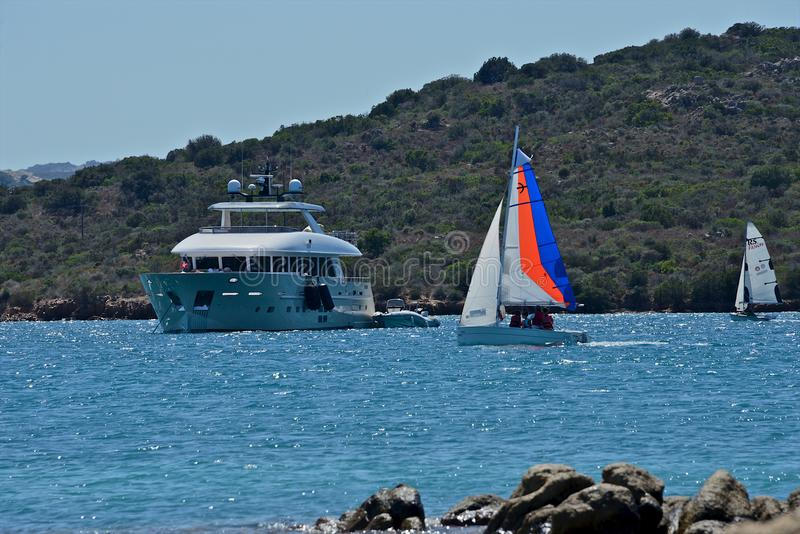 Yachts moored and sailing boats in a blue sea royalty free stock photography