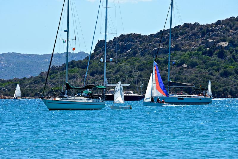 Yachts moored and sailing boats in a blue sea royalty free stock images