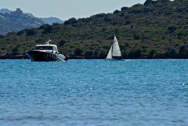 Yachts moored and sailing boats in a blue sea royalty free stock photos