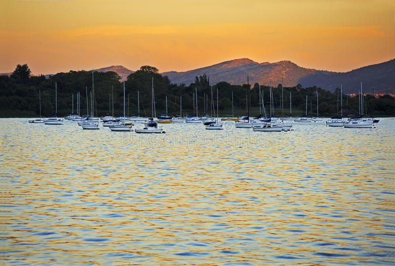 Download Yachts moored at sunset stock image. Image of light, ripple - 24049695