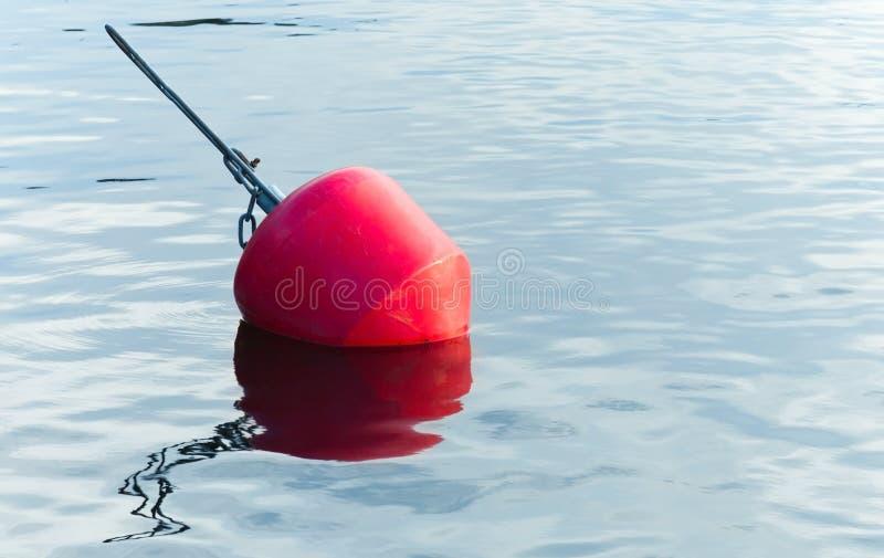 Yachts moorings red buoy. Of small European marina stock images