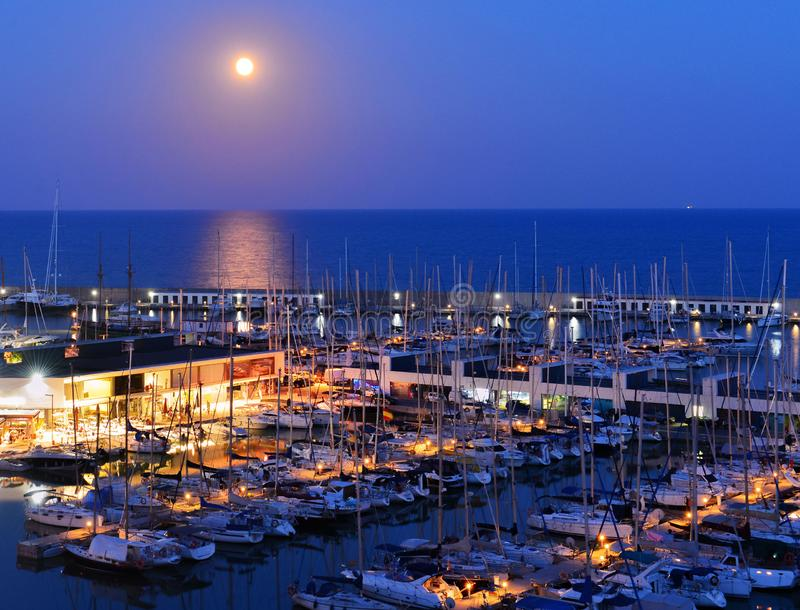 Yachts at night in Summer Spain near the Barcelona. royalty free stock photo
