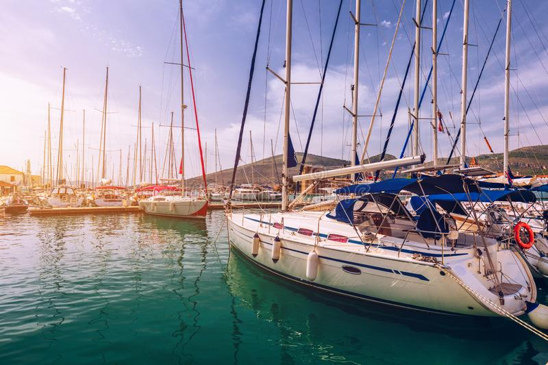 Yachts parking in harbor, Harbor in Trogir, Croatia. Sailboats reflected in water, water transport, beautiful vessel in the harbor stock images