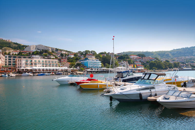 Yachts and pleasure boats are moored in Balchik. Yachts and pleasure boats are moored in marina of Balchik stock photos