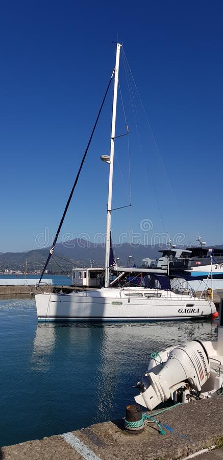 Yachts on the quay in the port. Yachts and other vessels on the quay of Batumi port in anticipation of exit to the Black Sea royalty free stock photography