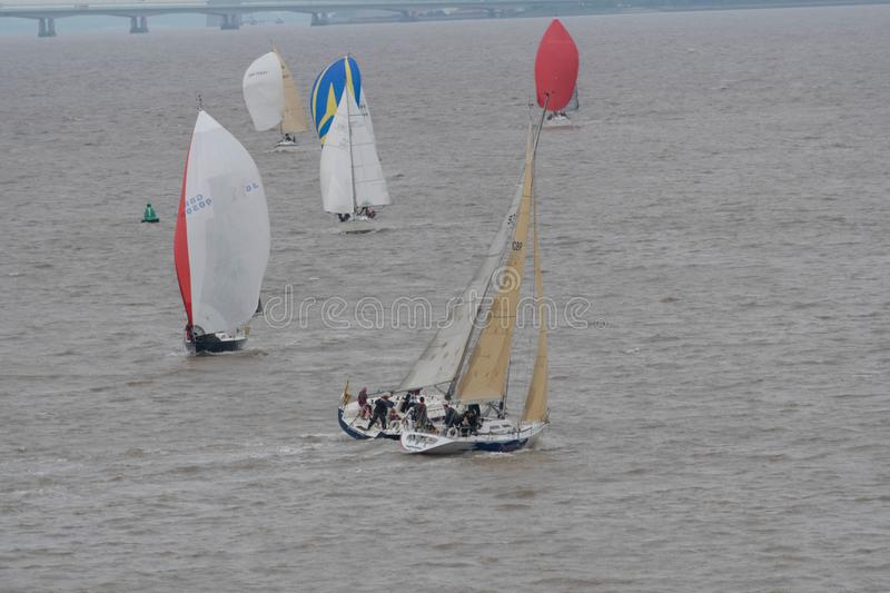 Yachts racing close hauled to each other. Yachts racing close hauled in the Severn estuary with spinnakers flying Great Britain stock image
