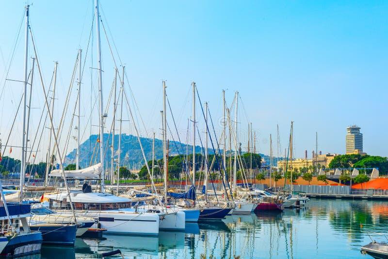 Yachts and sailboats in marina stock images