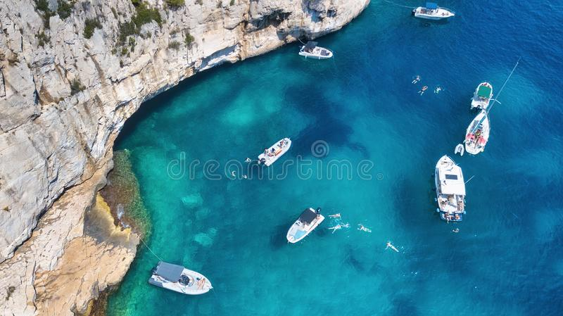 Yachts at the sea in France. Aerial view of luxury floating boat on transparent turquoise water at sunny day. Summer seascape from air. Top view from drone royalty free stock photo