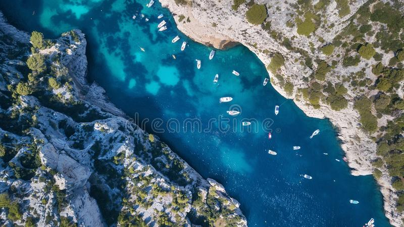 Yachts at the sea in France. Aerial view of luxury floating boat on transparent turquoise water at sunny day. Summer seascape from air. Top view from drone royalty free stock images
