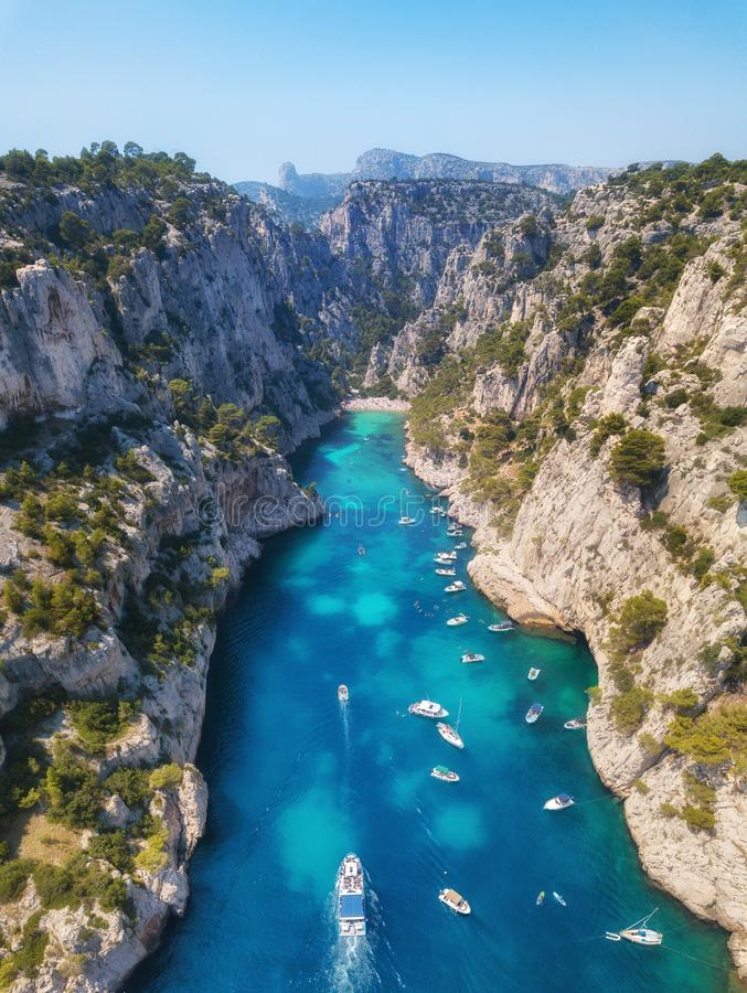 Yachts at the sea in France. Aerial view of luxury floating boat on transparent turquoise water at sunny day. Summer seascape from air. Top view from drone stock images