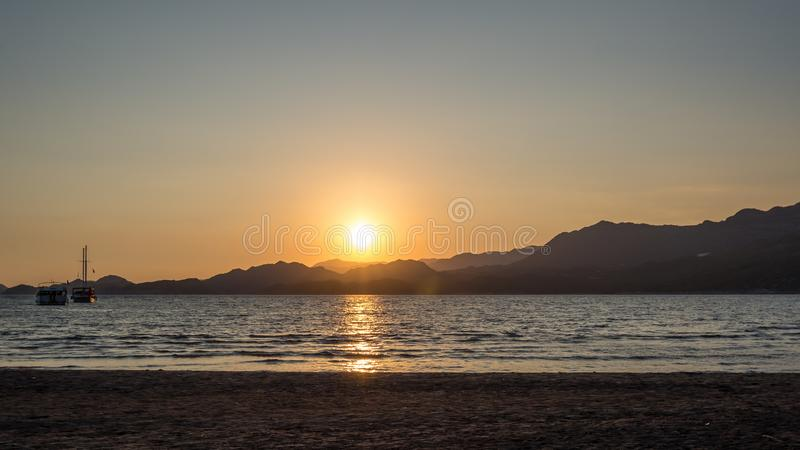 Yachts in the sea at sunset, Yachting. Romantic trip on luxury yacht during sea sunset royalty free stock photos