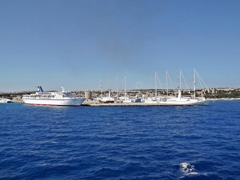 Yachts and ships in port of Rhodes, Greece. stock images
