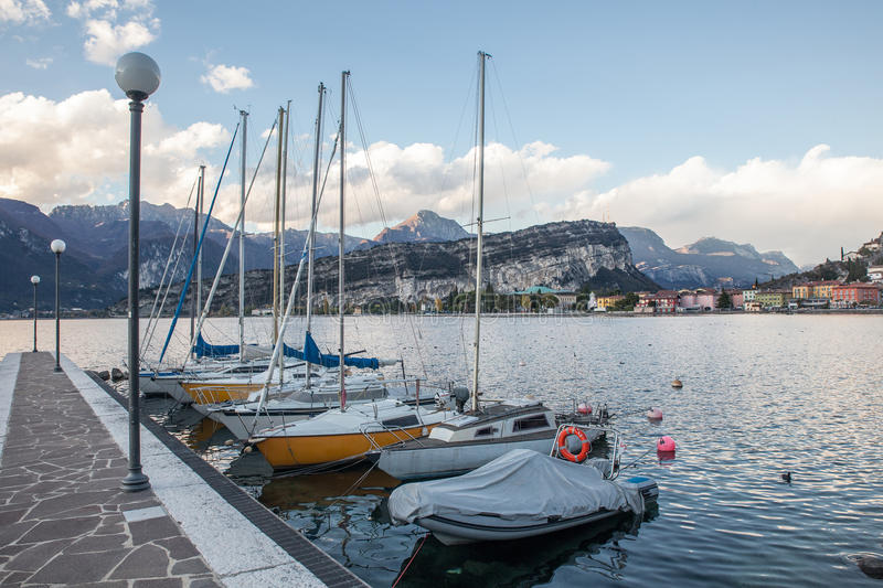 Yachts stand in lake. Of garda royalty free stock images
