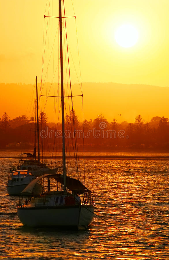Download Yachts In The Sun stock image. Image of glow, sailing - 14650955
