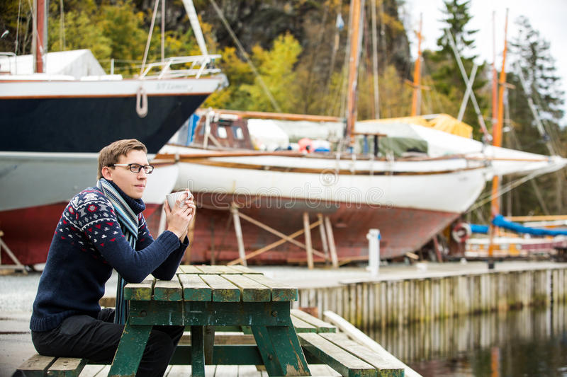 Yachtsman with coffee stock photography