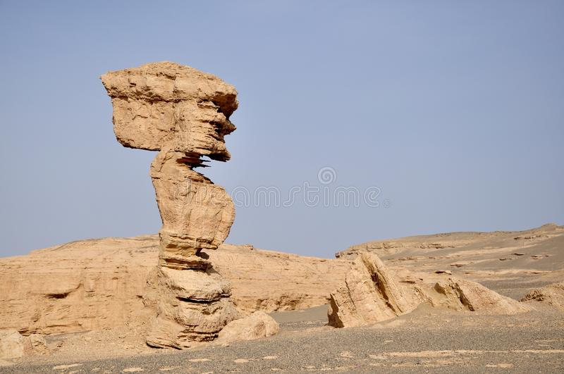 Yadan Geological Park, Dunhuang, China. An ET-like stone in Yadan National Geological Park, Dunhuang, China royalty free stock photo