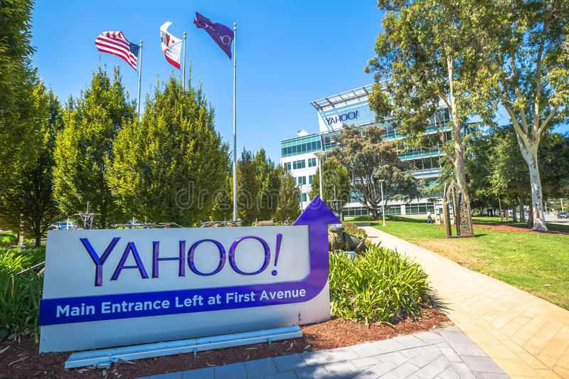 Yahoo Flag Sunnyvale. Sunnyvale, California, United States - August 15, 2016: flags in front of Yahoo Headquarters with American Flag and flag with Yahoo icon royalty free stock photos