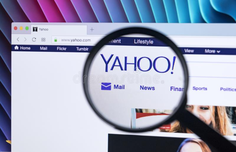 Yahoo homepage website on iMac monitor screen under a magnifying glass. Yahoo is a multinational Internet corporation with search royalty free stock images