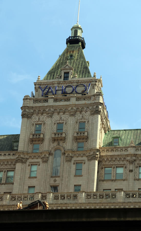 Yahoo Sign. Yahoo is a web services provider which was recently bought by Verizon. Yahoo sign on a building can be seen on 42nd street in Manhattan, NY stock photos