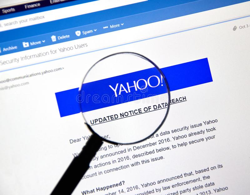 Yahoo updated Notice of newly discovered data breach. MONTREAL, CANADA - OCTOBER 9, 2017 : Yahoo updated Notice of data breach under magnifying glass. Yahoo is a royalty free stock photos