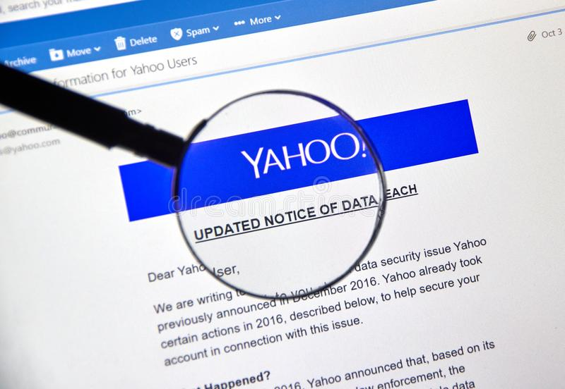Yahoo updated Notice of newly discovered data breach. MONTREAL, CANADA - OCTOBER 9, 2017 : Yahoo updated Notice of data breach under magnifying glass. Yahoo is a stock photos