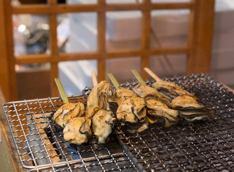 Yakitori sea food oysters at street stall royalty free stock photo