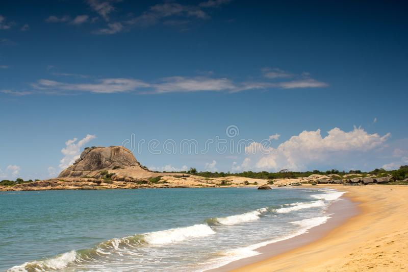 Yala National Park Sri Lanka. View of the beautiful beach. And big rock mountain in background stock images