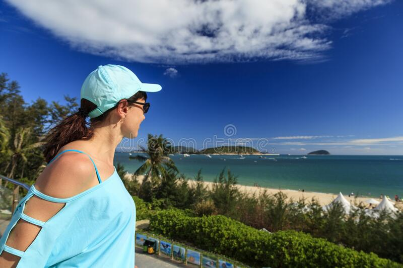 Yalong Bay, the best beach in Hainan Island, The girl admires the beautiful beach.  royalty free stock images