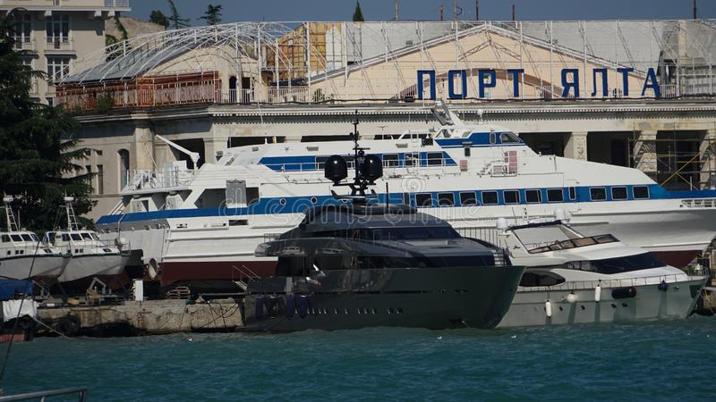 Yalta, Crimea - JULY 28, 2017. Yachts at the pier in the port. Yalta embankment stock images