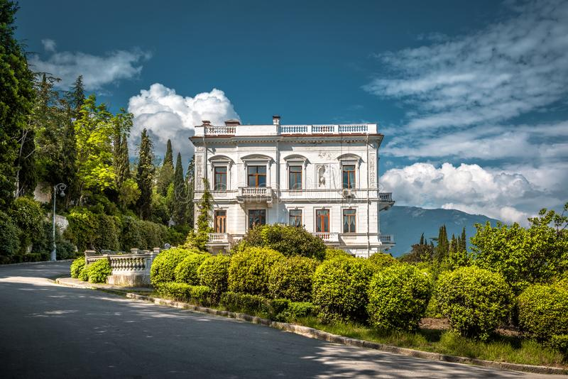 Scenic side view of Livadia Palace in summer, Crimea. Yalta, Crimea - May 17, 2016: Scenic side view of Livadia Palace in summer, Crimea, Russia. Livadia Palace stock image