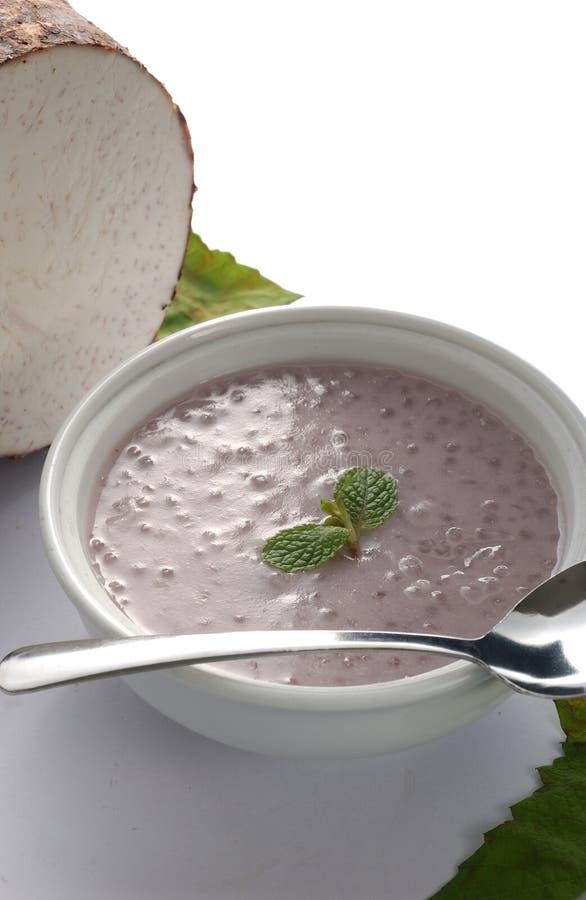 Yam porridge. A bowl of yam porridge with yum as a background royalty free stock image