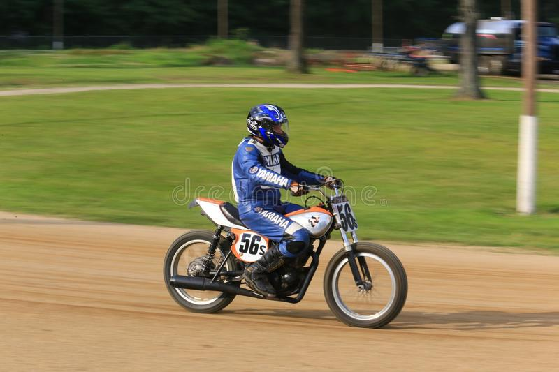 Yamaha dirt bike. Races the course at the pro motorcycle racing event on the dirt oval track speedway, Ashland County, Ohio, USA stock photos
