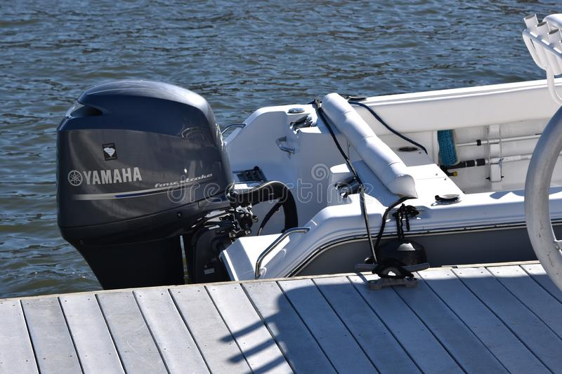 Yamaha outboard motor on a boat. Outboard motor on the back of a boat at Hilton Head Island in South Carolina. The boat is docked in the harbor royalty free stock photography