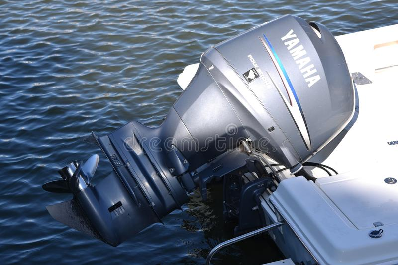 Yamaha outboard motor on a boat. Outboard motor on the back of a boat at Hilton Head Island in South Carolina. The boat is docked in the harbor royalty free stock images