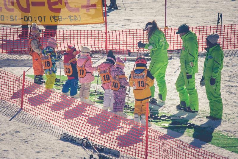 Yamanashi, Japan - January 26, 2018 : Group of Japanese little cute or kids studying ski training courses at ski resort. stock image
