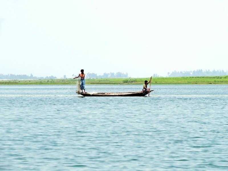 Yamuna River, Brahmaputra River, Bogra, Bangladesh. Fisher men pulling net, Yamuna River, Brahmaputra River, Sariaknadi, Bogra Bangladesh stock photo