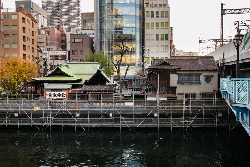 Yanagimori Shrine is a small Shinto shrine in Chiyoda ward, Tokyo, located alongside the Kanda stock photography